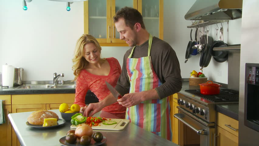 Young couple preparing food in kitchen - HD stock footage clip
