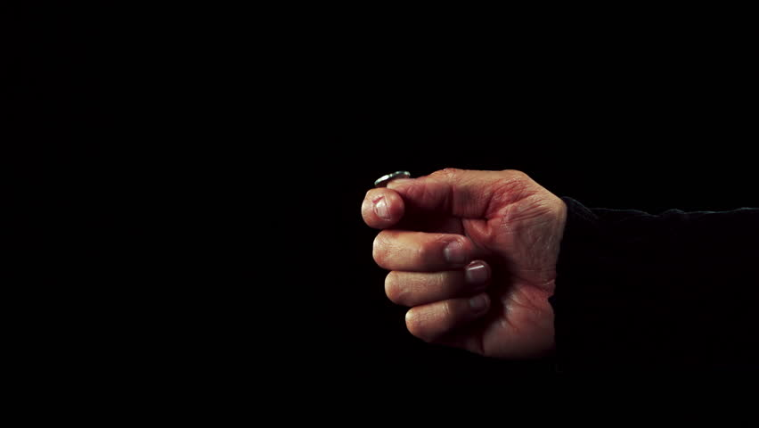 Hand tossing a coin in slow motion - HD stock video clip