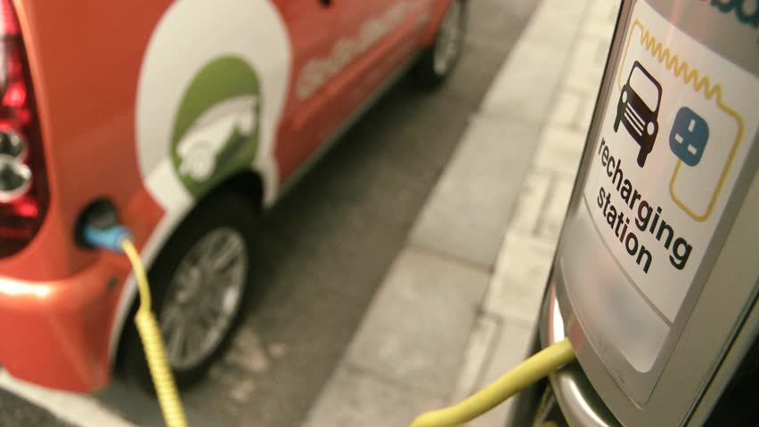 Electric car wired to charging station