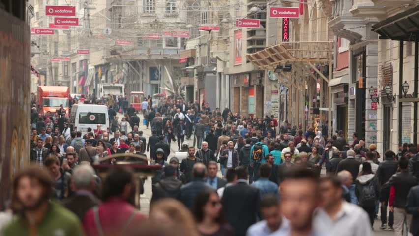 ISTANBUL,TURKEY - November 13, 2015 : Crowds walk and shop in one of the most busy  street namely Istiklal Street in Istanbul