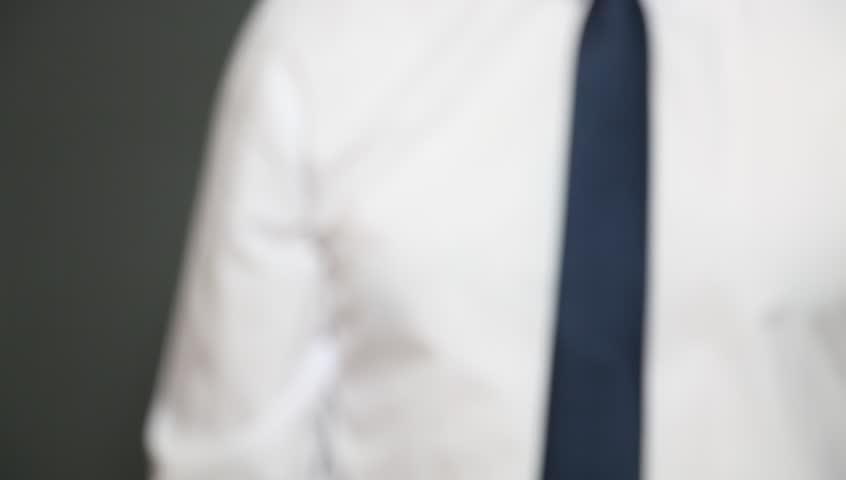 Businessman showing an empty business card, closeup shot