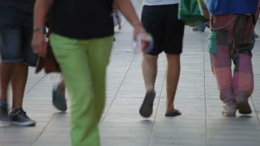 People walking on the sidewalk in town