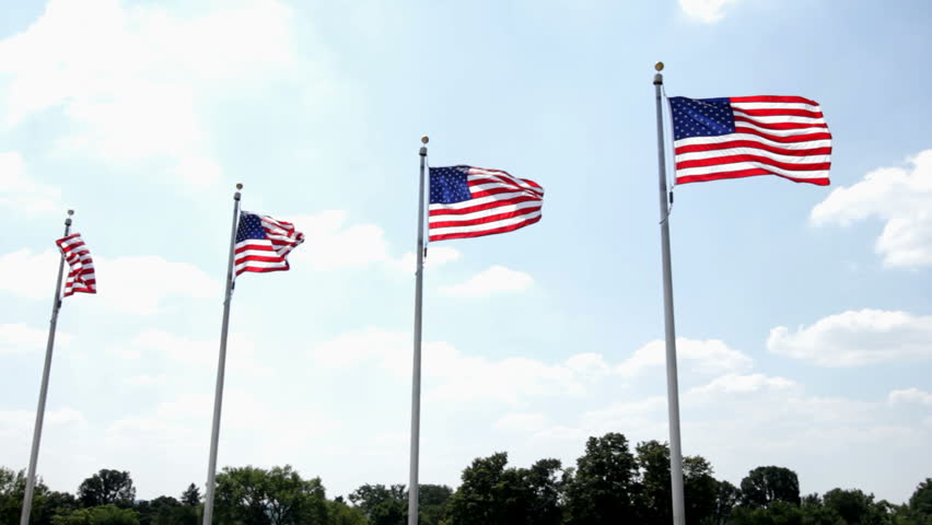 Four flags in a row blowing in wind - HD stock footage clip