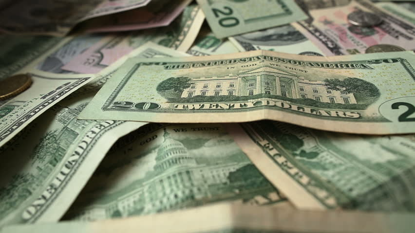 Dollar bills and coins, dolly shot, close up. Full HD - HD stock footage clip
