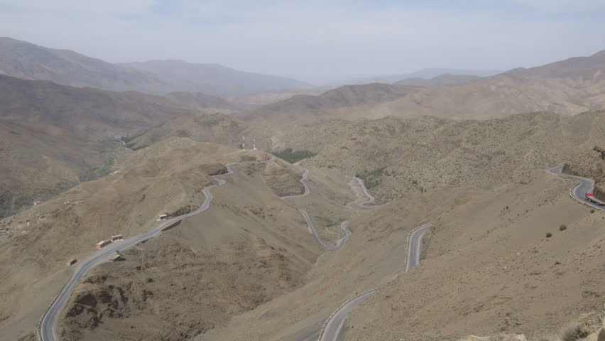 Windy roads in Morocco. Wide overhead aerial landscape, mountains.
