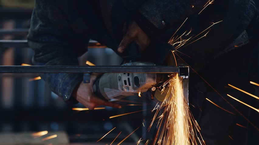 Power tools for grinding work. A lot of spectacular sparks