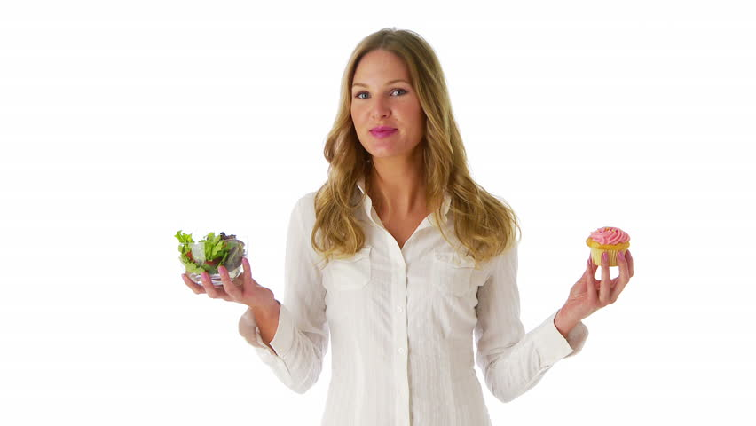 Woman deciding between salad and cupcake - HD stock video clip