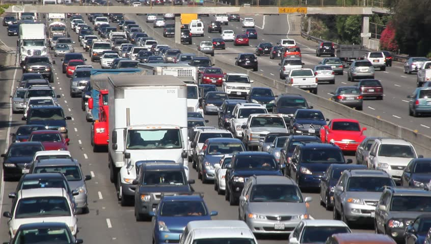 LOS ANGELES - AUGUST 4: Thousands of cars drive on California freeway on August 4, 2011 in Los Angeles, California, USA. The Southern California network of interconnected freeways serve a population of 22 million.