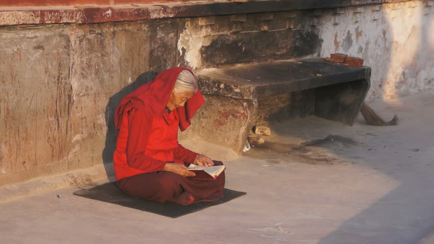KATHMANDU, NEPAL - 3. JANUARY, 2014: Pilgrim in the Boudhanath Stupa in the Kathmandu, Nepal 3. January, 2014. Boudhanath is a UNESCO World Heritage Site, and it is a popular tourist destination. - HD stock footage clip