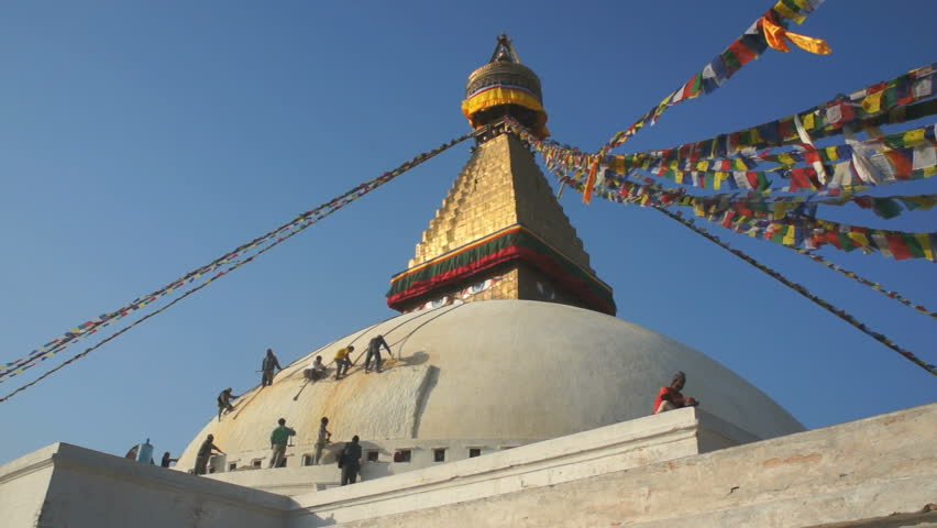 KATHMANDU, NEPAL - 3. JANUARY, 2014: The Boudhanath Stupa in the Kathmandu, Nepal 3. January, 2014. Boudhanath is a UNESCO World Heritage Site, and it is a popular tourist destination. - HD stock footage clip