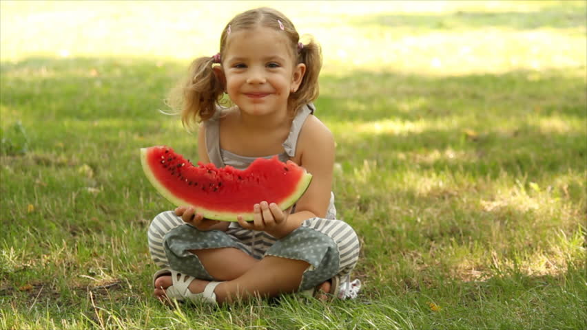 little girl eats watermelon - HD stock footage clip
