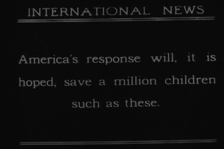 CIRCA 1920s - Will Kellogg and Elmer Burland feed starving Russian children.