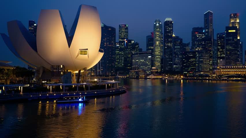 Singapore - Nov 13: 4k UHD Time-lapse of illuminated city skyline view. November 13, 2015