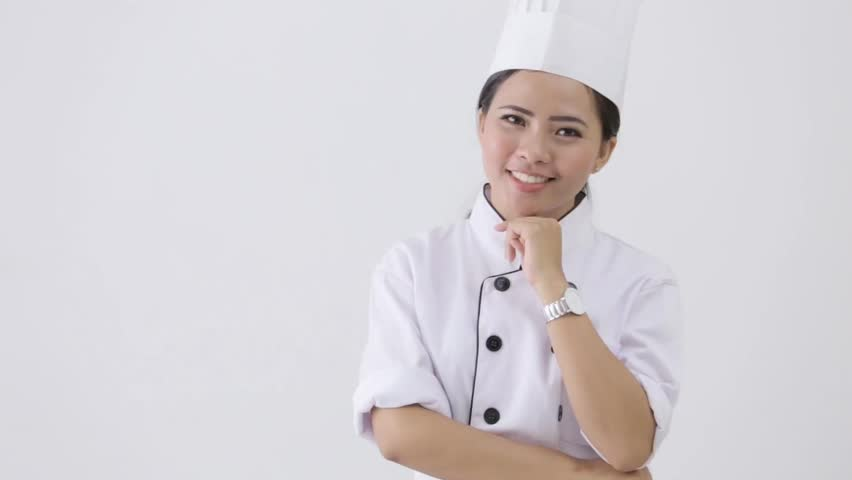 happy young female chef on white background - HD stock footage clip