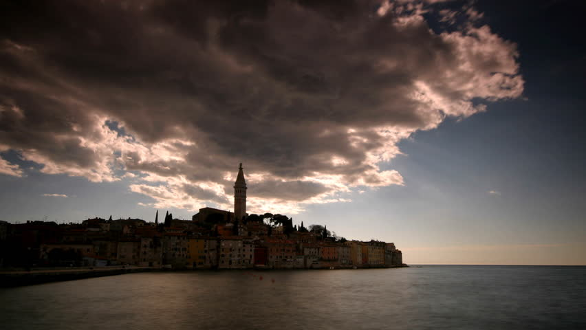 Rainy clouds passing and sun coming out over beautiful Rovinj  - HD stock video clip