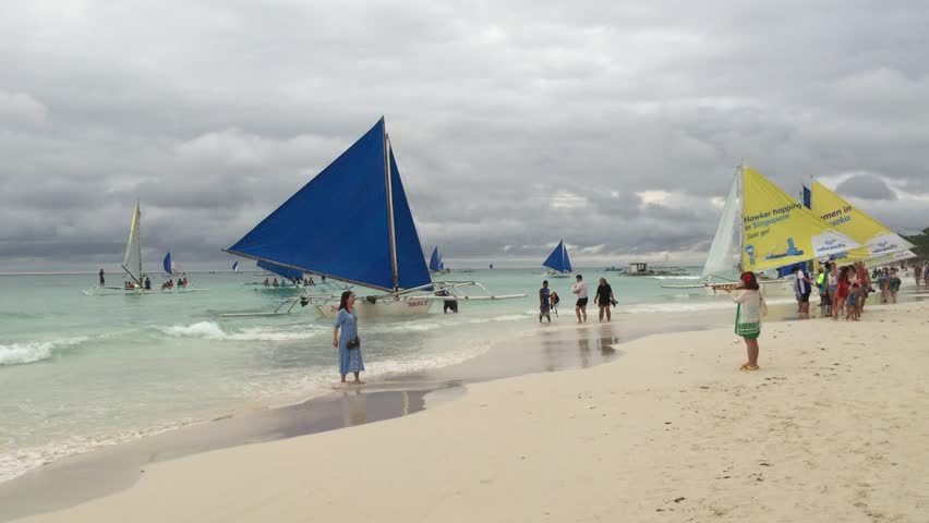 BORACAY, PHILIPPINES - OCT 3, 2014: View of the tropical beach with sail boats in Boracay island, Philippines.