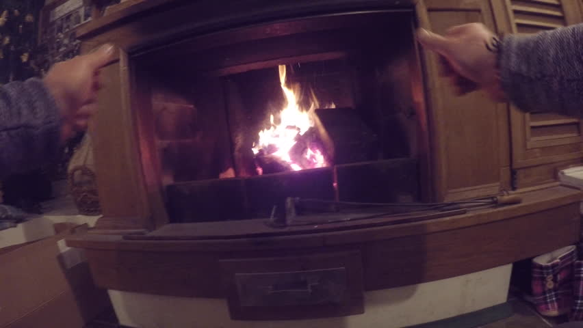 Warming up at fireplace - 4K stock video clip