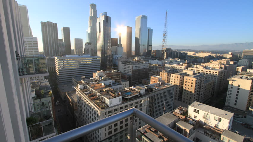 Gorgeous Forward-Sliding Timelapse above Balcony Railing onto Downtown Los Angeles during Nightfall (camera slides forward for the first 9 seconds then stays steady)