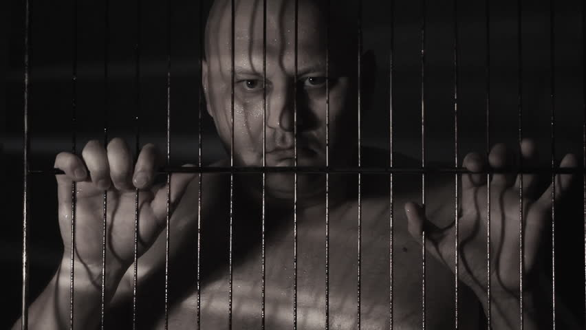 Prisoner in jail cell - HD stock video clip