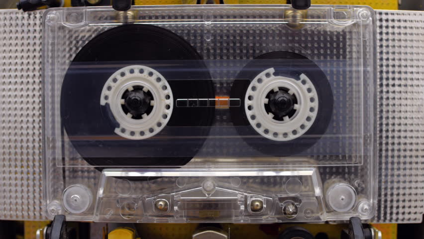The cassette with standard reels is played in the tape deck recorder and rewind the reel of the tape. Closeup
