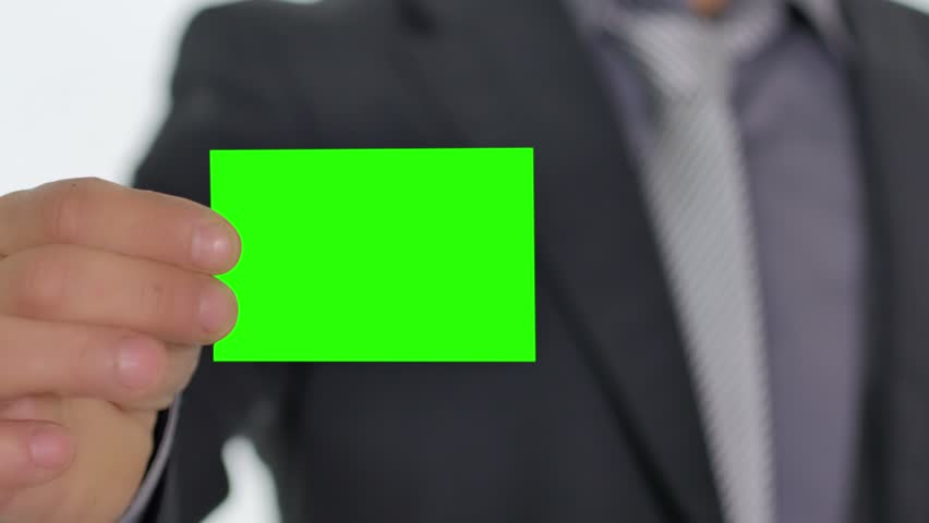 male hand giving showing a green business card to the camera pre keyed