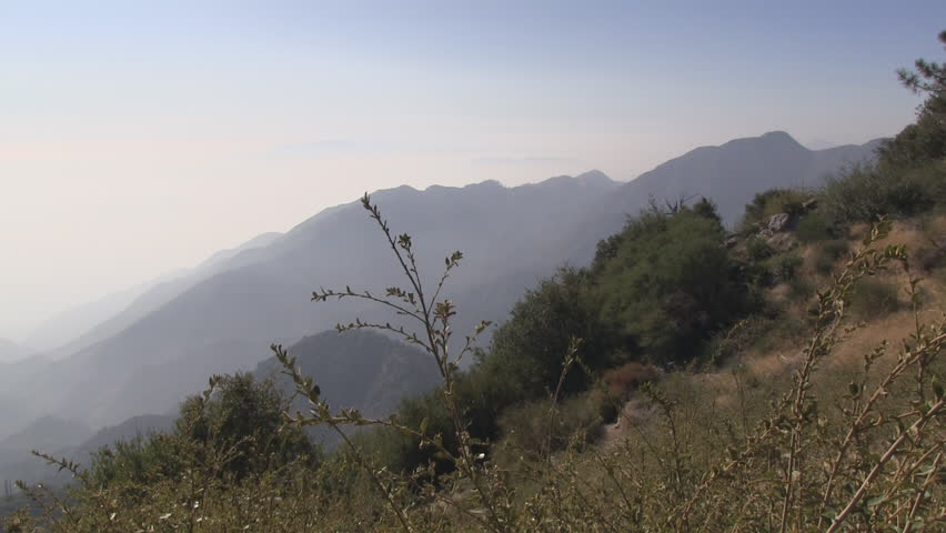 Panning shot from right to left atop Mount Wilson showing smog.