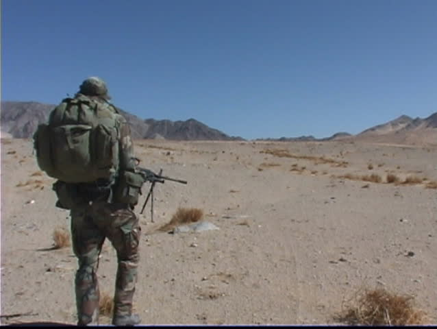 Marines patrolling the desert - SD stock video clip