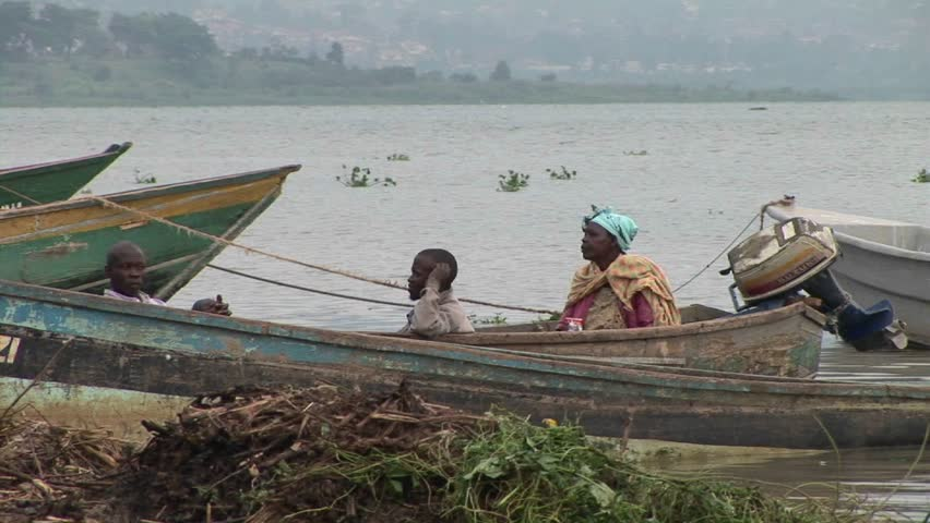 LAKE VICTORIA, UGANDA - CIRCA 2009: African fishers rest in a boat circa 2009 on the shore of Lake Victoria. - HD stock footage clip