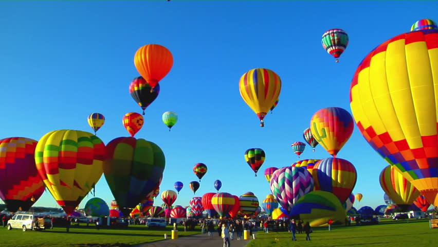Pan across beautiful balloons launching at the Albuquerque balloon festival