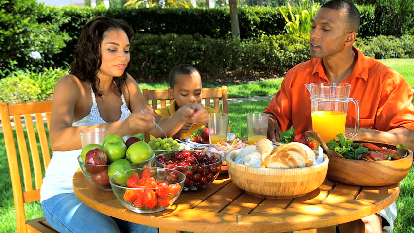 Young Ethnic Family Sharing a Healthy Lunch Outdoors - HD ...