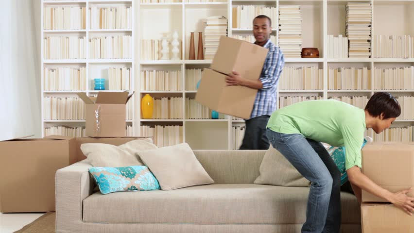 Family moving boxes and sitting on sofa - HD stock footage clip