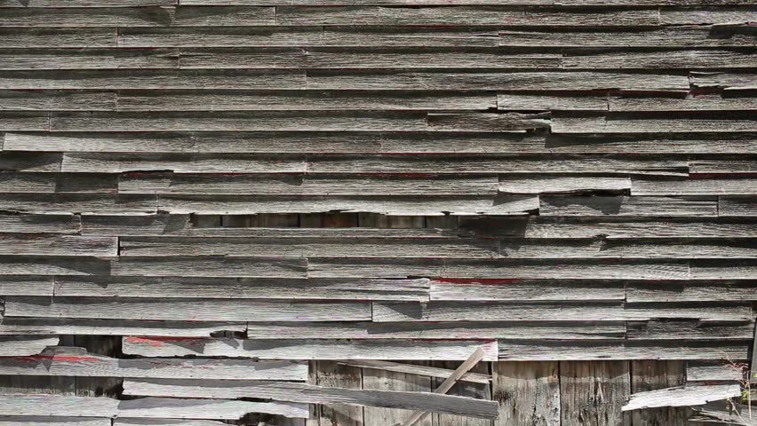 ETNA, NEW HAMPSHIRE May 18th: Old weathered clapboards on the side of an old New England barn in Etna, New Hampshire on May 18th, 2016 in Etna, New Hampshire.