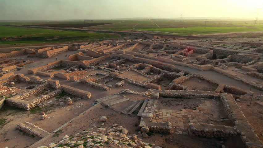 Wide shot from a high angle of the ruins of the biblical city at Tel Be'er Sheva National Park in Israel.   - HD stock footage clip
