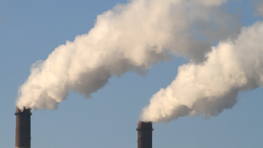 Smoke stack on blue sky background
