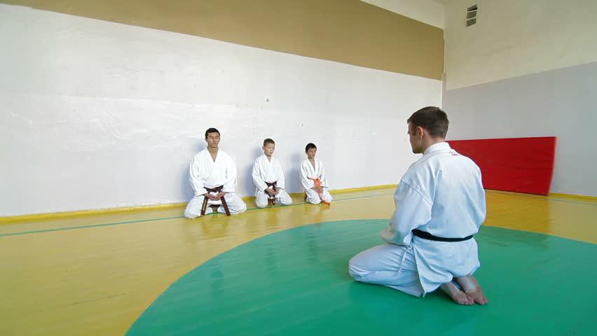 Coach At The Gym Teaches Children Martial Art Stock ...