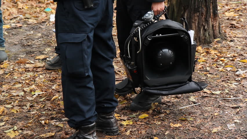 "Sound cannon. Toronto police with LRAD (long range acoustic device), or ""acoustic weapon"".  - HD stock video clip"