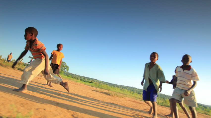 KENYA, AFRICA - CIRCA 2011:  Children playing soccer on the fields in Kenya, Africa. - HD stock footage clip