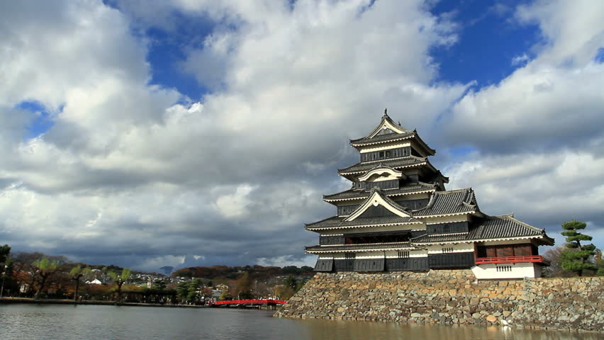 Japanese Castle with clouds in the background.