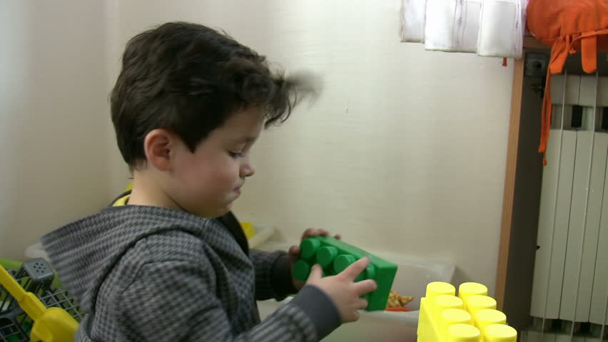 Little Boy playing toys in the kindergarten - HD stock video clip