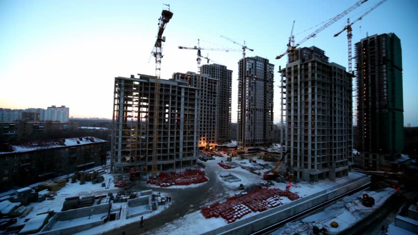 laborers and building materials at construction site in