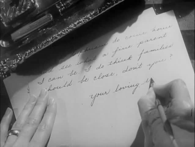 Close-up hands of woman writing letter