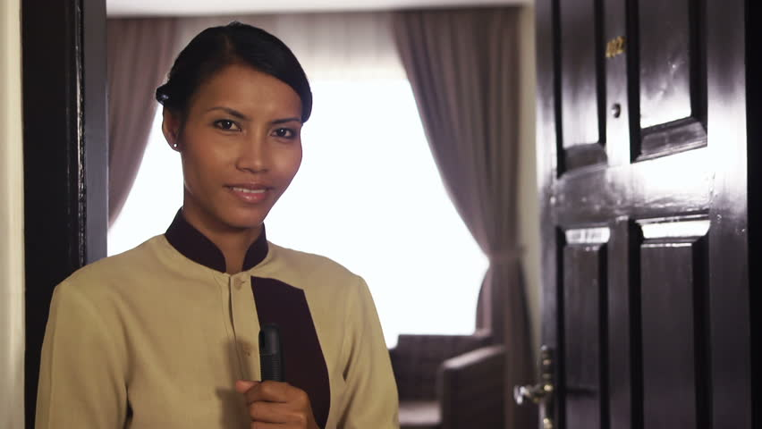 Portrait of happy Asian housemaid at work in luxury hotel room and smiling at camera. Young people at work, woman, girl, job, professions - HD stock footage clip