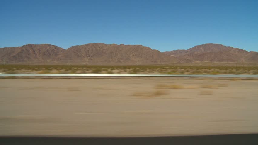 drive plate, in the desert with traffic