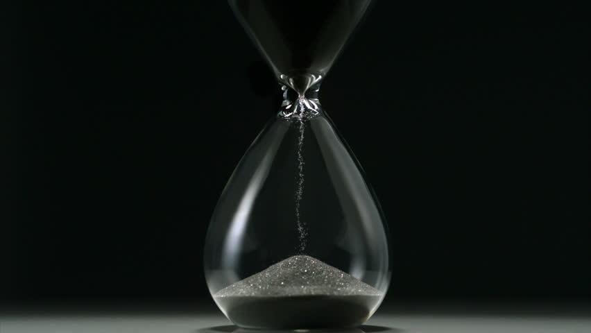 Sands move through hour glass