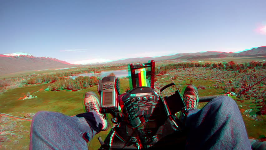 3D stereoscopic anaglyph aerial flying an ultralight aircraft from view of the pilot during flight over rural farming pond or lake.