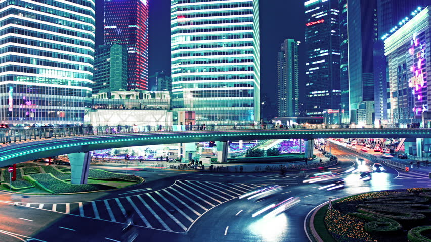 the light trails of city traffic on the modern building background in shanghai china. timelapse - HD stock footage clip