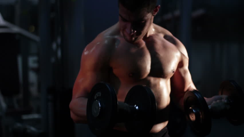 bodybuilder exercising biceps at gym