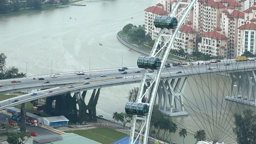 "Aerial View of East Coast PKWY Highway big traffic ""Rush Hour"" near Singapore Flyer, Kallang Basin - HD stock video clip"