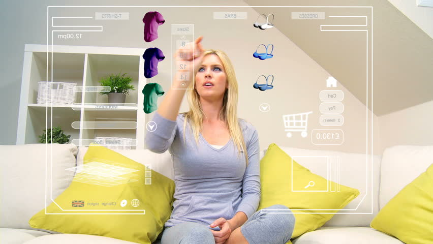Touchscreen graphic technology being accessed by caucasian female for home shopping