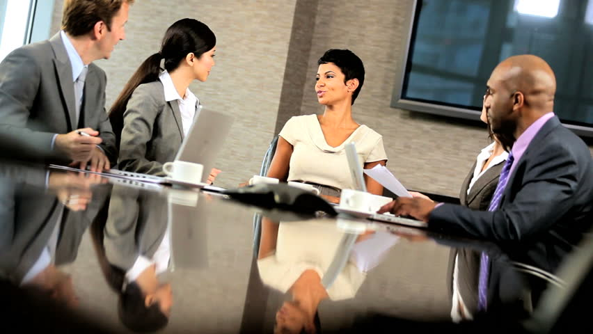 Female african american executive congratulating her business team on news of success